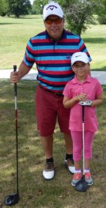 Jeff and Lisa Copeland prepare to tee off in the annual Applebee's Parent-Child event on Father's Day prior to the start of Little People's.